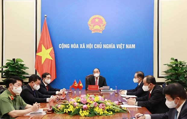 President holds phone talks with top Chinese leader hinh anh 1