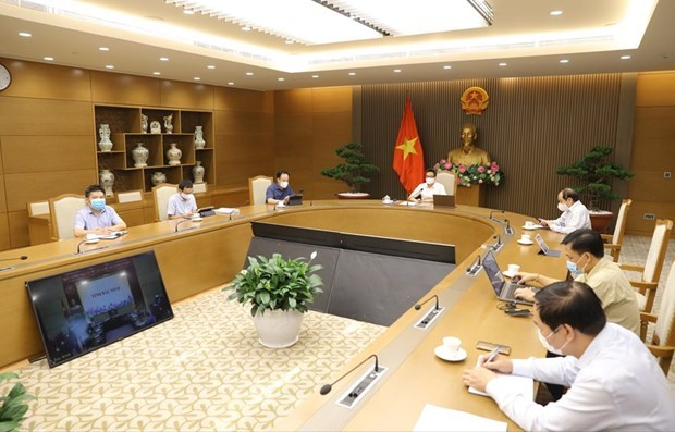 Bac Giang, Bac Ninh asked to control COVID-19 spread at industrial zones hinh anh 1