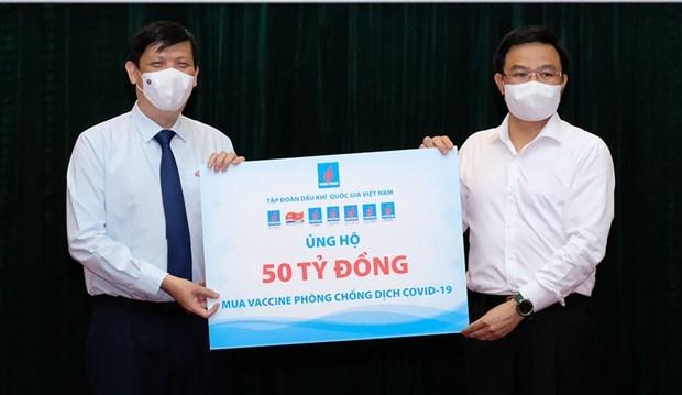 COVID-19 vaccine fund raises 185 billion VND hinh anh 1