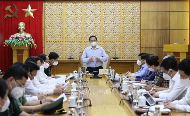 PM urges tackling difficulties for Bac Giang amid COVID-19 hinh anh 1