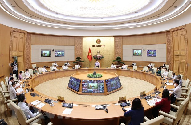 PM chairs national teleconference on COVID-19 prevention and control hinh anh 1