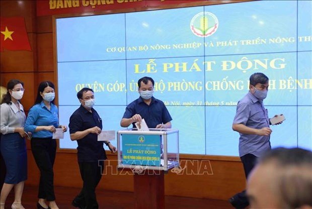 Ministries, agencies support COVID-19 combat hinh anh 1