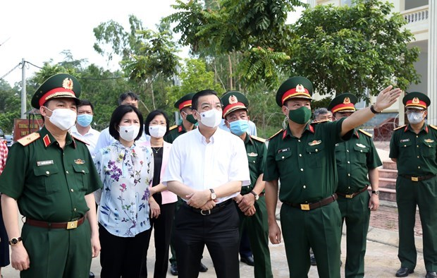 Hanoi determined to reduce infection risks in concentrated quarantine areas hinh anh 1
