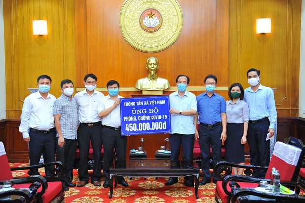 COVID-19 fight gains additional support hinh anh 1