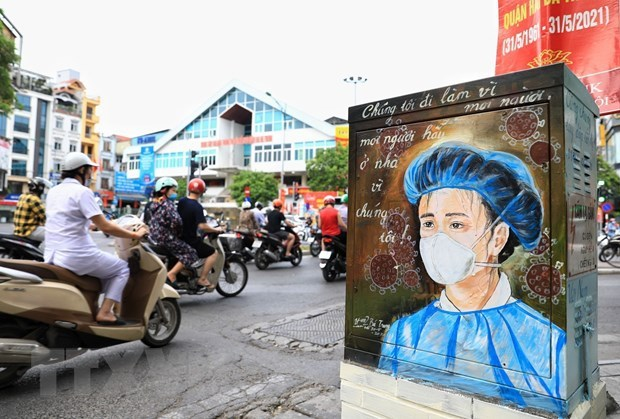 Lao PM extends sympathy to Vietnam over COVID-19 outbreak hinh anh 1