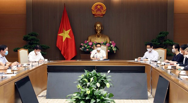 Deputy PM lauds businesses' contributions to COVID-19 vaccine fund hinh anh 2