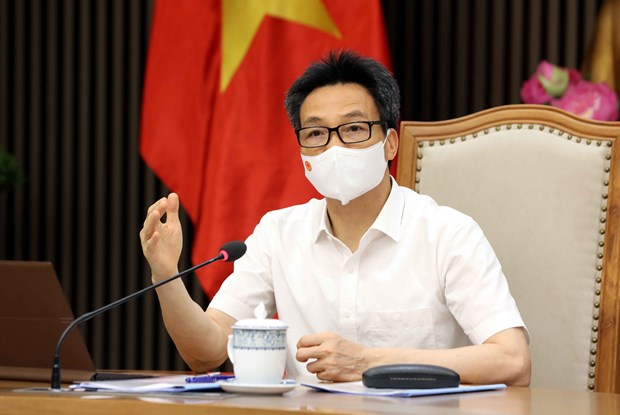 Deputy PM lauds businesses' contributions to COVID-19 vaccine fund hinh anh 1