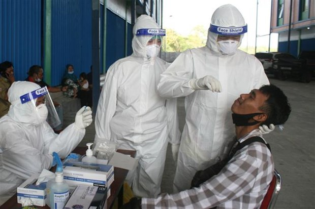 Indonesia sees highest daily COVID-19 new cases in three months hinh anh 1