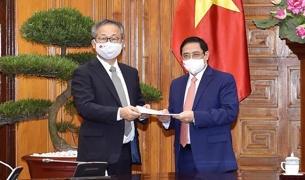 PM hopes for Japan's continued cooperation in pandemic combat hinh anh 1