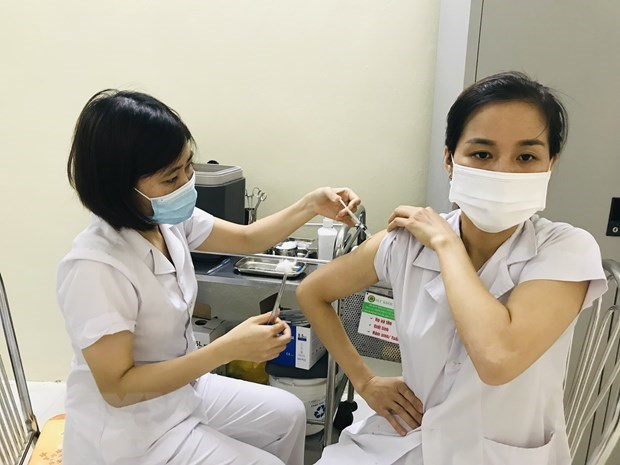 Over 966,000 doses of COVID-19 vaccine to be distributed nationwide hinh anh 1