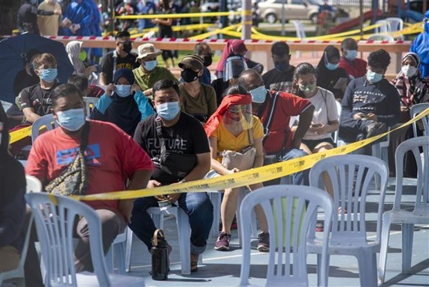 COVID-19: Malaysia worries about sporadic cases, Cambodia logs higher death toll hinh anh 1