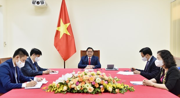 PM proposes WHO support and prioritise vaccine delivery to Vietnam hinh anh 1
