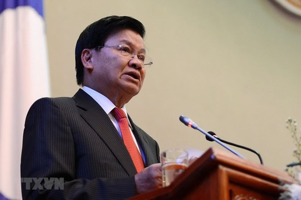 Lao leader's Vietnam visit contributes to tightening bilateral relations hinh anh 1