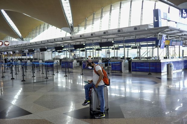 Malaysian government tightens SOPs for arrivals hinh anh 1