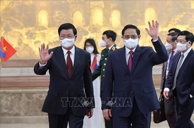 Vietnamese, Lao leaders agree on cooperation orientations hinh anh 1