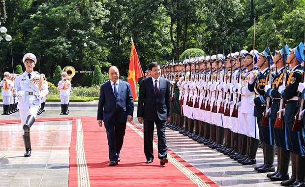 Welcome ceremony held for top Lao leader Thongloun Sisoulith hinh anh 1