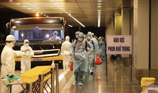 Vietnam to pilot 7-day quarantine for fully vaccinated travellers hinh anh 1