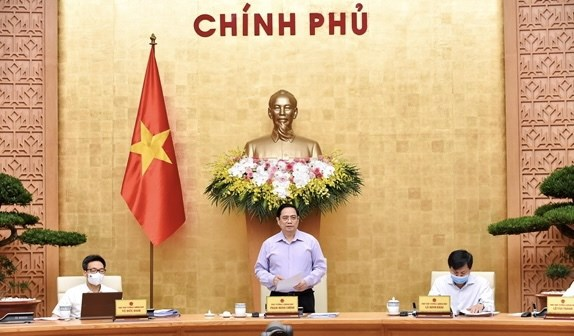 PM chairs Government meeting on law building hinh anh 1