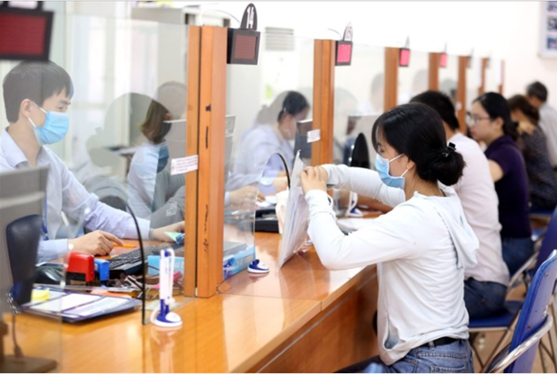 Vietnam's average monthly income in 2020 down 1 percent hinh anh 1
