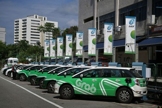 Grab to give commuters choice of electric or hybrid vehicles hinh anh 1