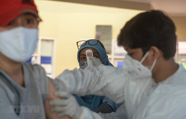 New COVID-19 cases surge in Southeast Asian nations hinh anh 1