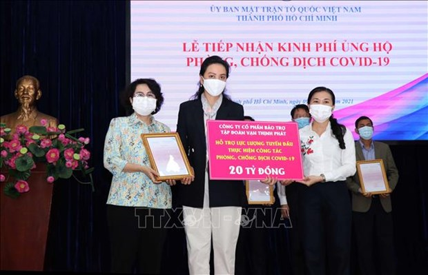 HCM City's COVID-19 control fund receives over 1 trillion VND hinh anh 1