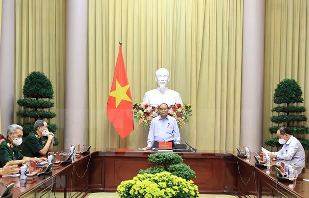 President affirms policies towards revolution contributors, AO victims hinh anh 1