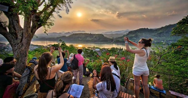 Laos prepares for reopening tourism under new normal conditions hinh anh 1