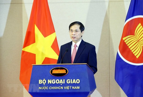 Flag salute ceremony celebrates ASEAN's 54th founding anniversary in Hanoi hinh anh 1