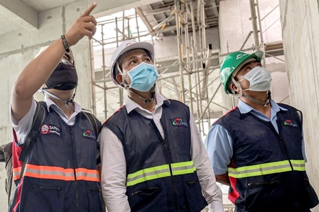 Construction firms see divergent earning results amid rising material prices hinh anh 1