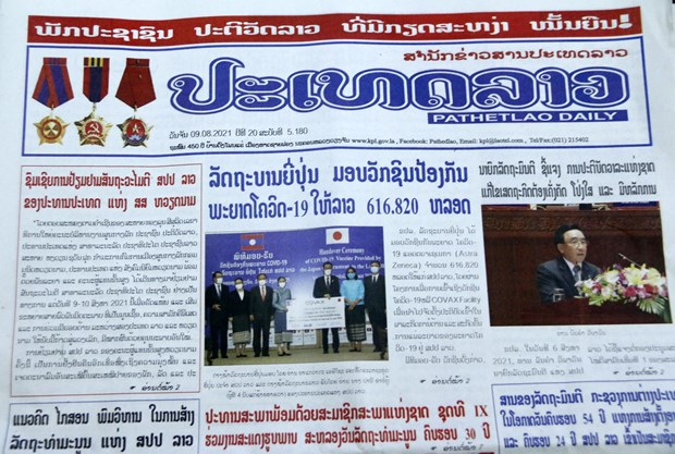 Lao newspapers hail Laos-Vietnam traditional friendship, comprehensive cooperation hinh anh 1