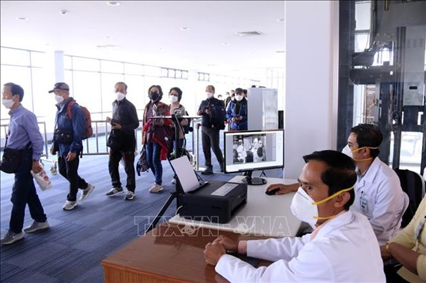 COVID-19: Laos works to tackle high number of arrivals, Indonesia extends social restrictions hinh anh 1