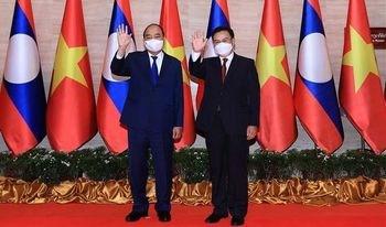Lao media spotlights Vietnamese President's visit hinh anh 1