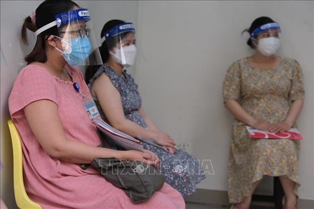 HCM City begins COVID-19 inoculation for expectant women hinh anh 1