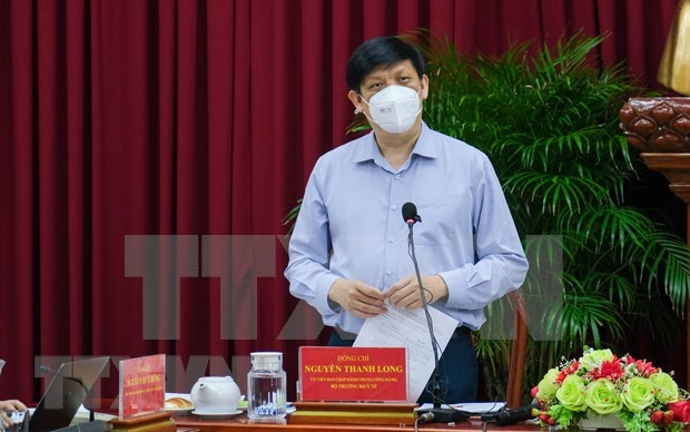 Localities asked to adopt three-tiered COVID-19 treatment model hinh anh 1