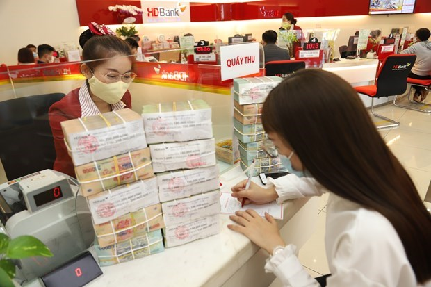 Reference exchange rate up 8 VND at week's beginning hinh anh 1