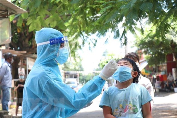 Vietnam records additional 9,605 COVID-19 cases hinh anh 1