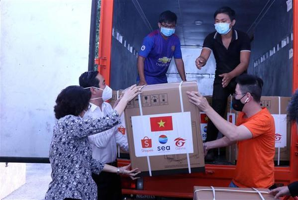 MIC launches programme to support COVID-19 hit people in HCM City hinh anh 1