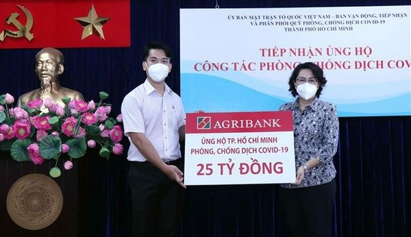 MIC launches programme to support COVID-19 hit people in HCM City hinh anh 2
