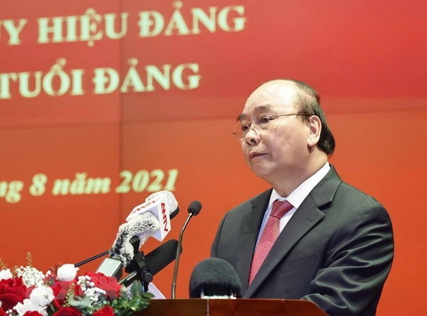 President attends gathering marking Day of People's Public Security Forces hinh anh 1
