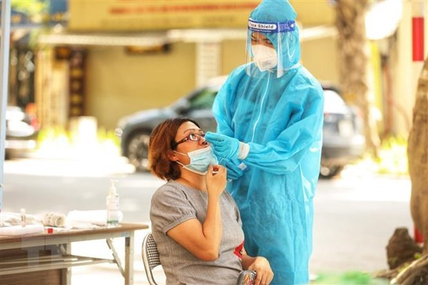 COVID-19: Daily infections surpass 11,000 hinh anh 1