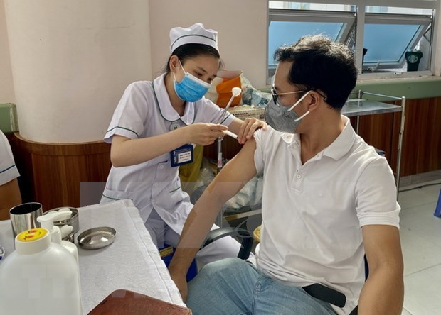 Vietnam records 11,214 new COVID-19 cases on August 22 hinh anh 1