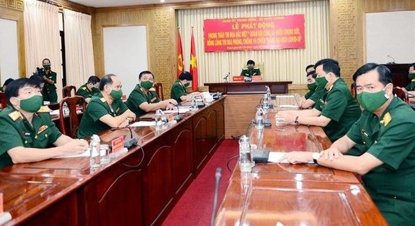 Military emulation movement aims to join hands in stamping out COVID-19 hinh anh 1