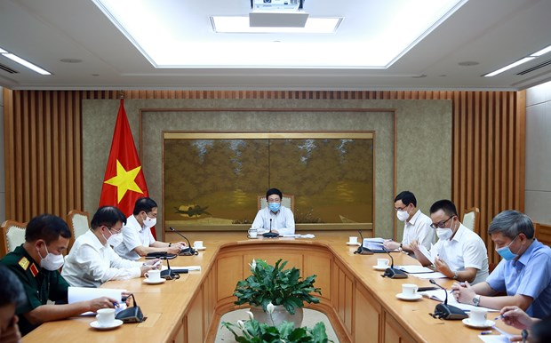 Meeting discusses COVID-19 vaccine diplomacy hinh anh 1