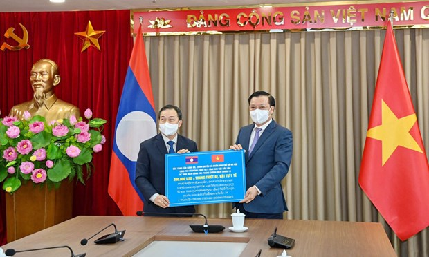 Capital cities of Vietnam, Laos foster multi-faceted cooperation hinh anh 1