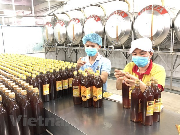 US postpones preliminary anti-dumping determination on imported raw honey hinh anh 1