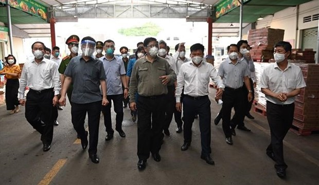 PM asks Binh Duong to quickly conduct COVID-19 testing for residents hinh anh 1