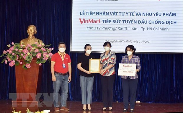 Masan Group donates 16-billion-VND COVID-19 aid for over 300 localities in HCM City hinh anh 1
