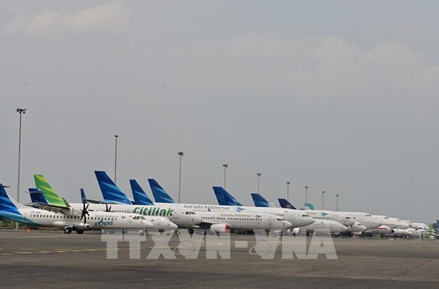 Indonesian national flag carrier reports nearly 900 million USD net loss in H1 hinh anh 1