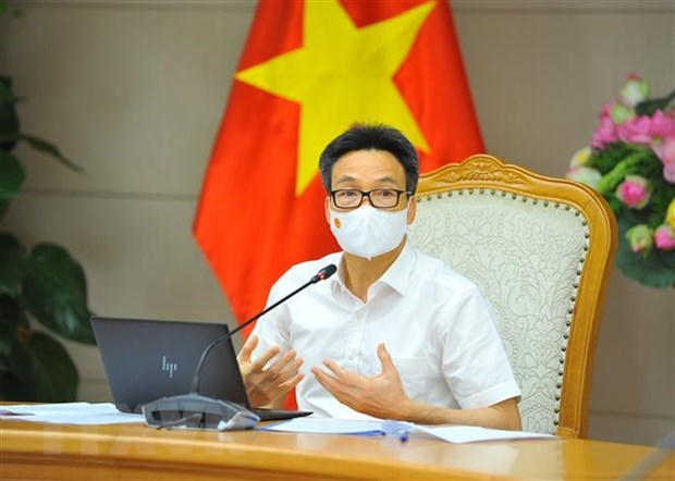 At least one domestic COVID-19 vaccine to be licenced by year-end hinh anh 1